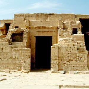 This consists of a large rectangular hall surrounded by a colonnade near the entrance to the site and has some well-preserved relief decoration on its exterior.