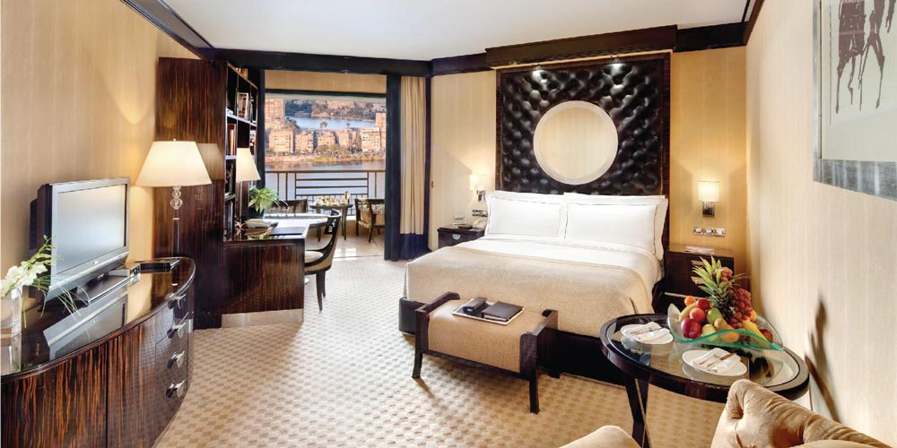 Bedroom of Fairmont Nile - Trips in Egypt