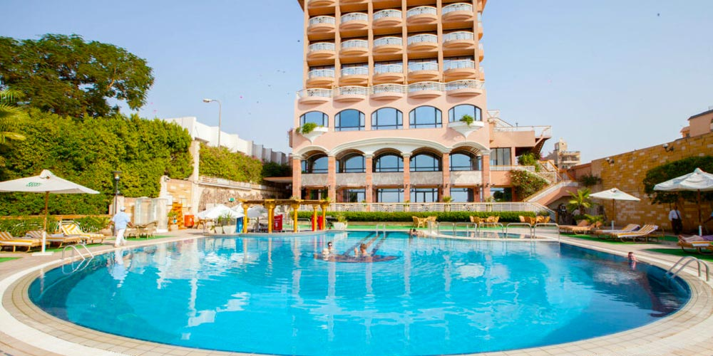 Swimming Pool of Sonesta St George - Trips in Egypt