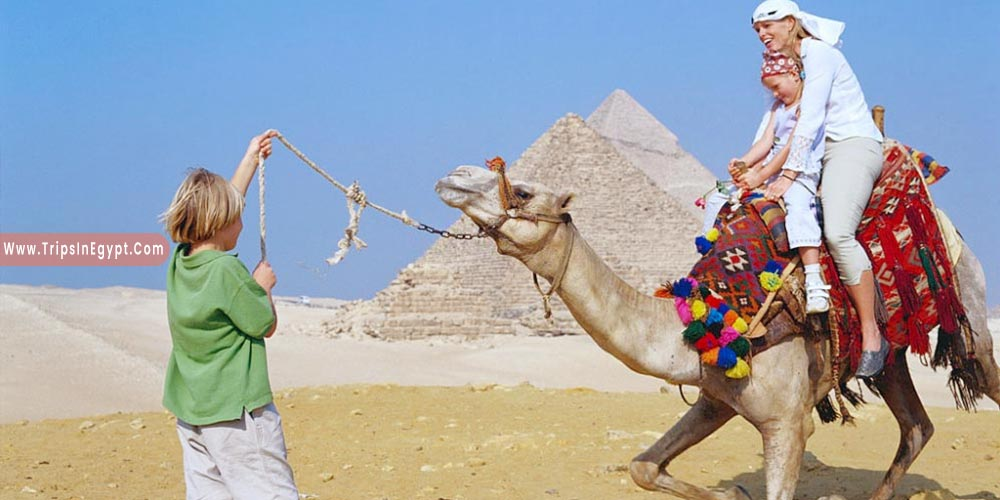 Ridiing Camels Giza Pyramids - Reasons to Visit Egypt - Trips in Egypt